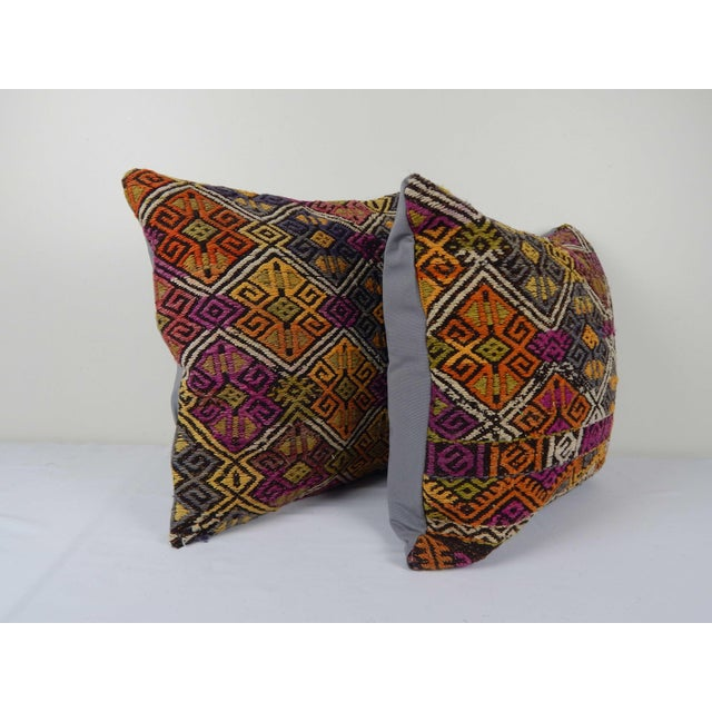 """These beautiful 18"""" x 18"""" pillow covers were made from an authentic, vintage Turkish rug handwoven in the 1960s. Bright..."""