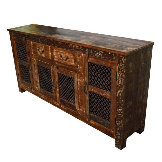 100% Handcrafted Industrial Style Rustic sideboard / Buffet Table made with reclaimed wood and aged iron grill. The piece...