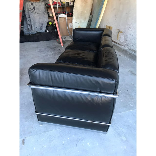 Iconic Le Corbusier three-seater black leather sofa with polished chrome, manufactured by Cassina. LC2 is a timeless...