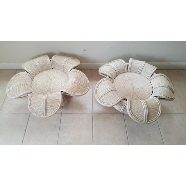 These are a gorgeous pair of flower coffee tables. They were made with split reed. Nice addition to your special place.