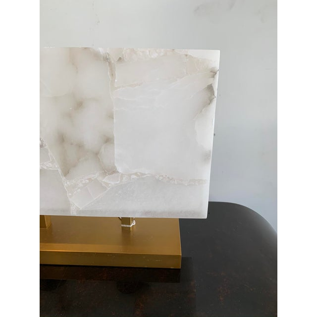 Alabaster stone lamp from Jamie Young. Alabaster is a natural stone offering veining, color and patterns unique to each...