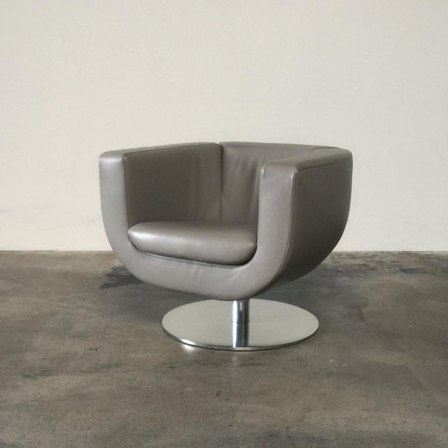 B&B Italia tulip chairs by Jeffrey Bernett, 2000. The B&B Italia Tulip swivel armchair in neutral, taupe colored leather...