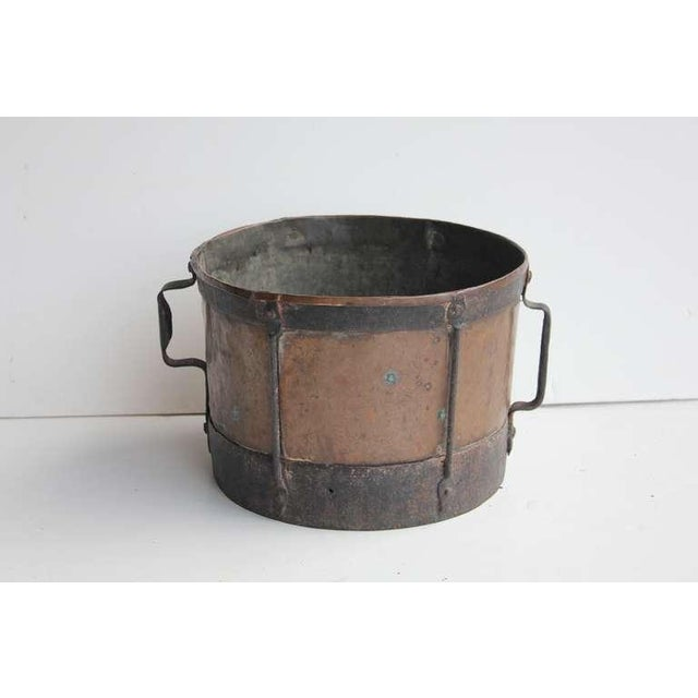 Antique original English copper and iron pot with handles. This piece would look great in a rustic style kitchen.