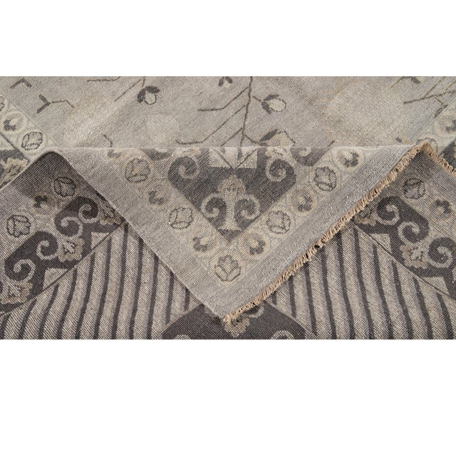 Beautiful hand-knotted wool, contemporary Kohtan wool rug. This rug has a gray field with dark grey accents with small...