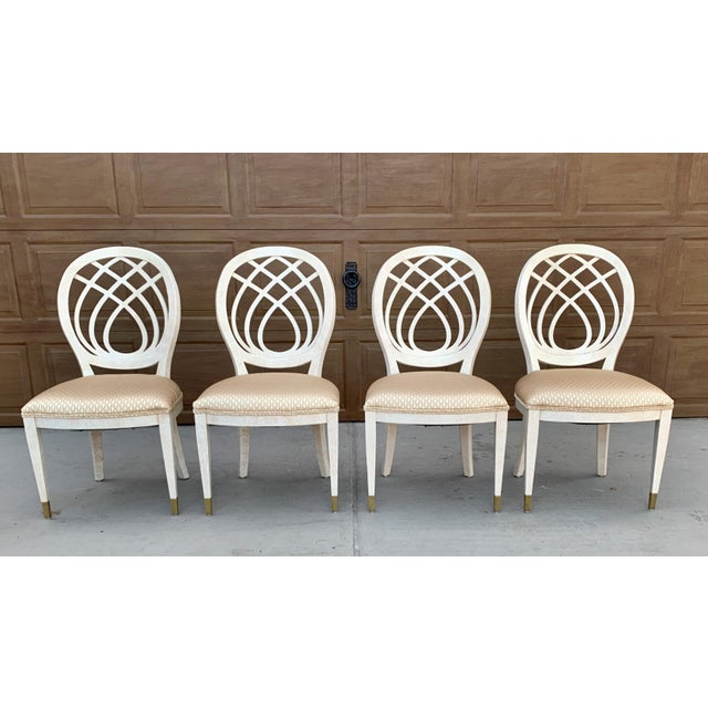 Two sets of two side chairs made by Henredon. High quality solid wood chairs with upholstered seats. The frames are white...