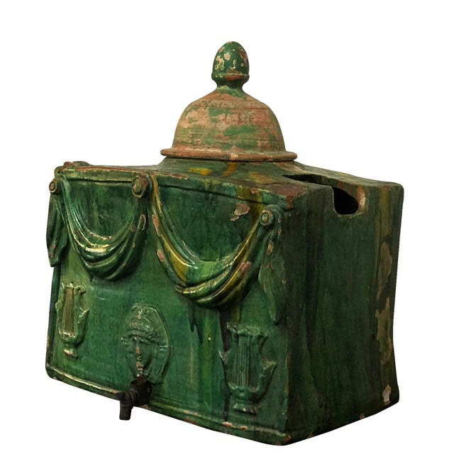 A very rare wine or water cooler glazed the traditional Provençal colors green, yellow and ochre made of glazed...
