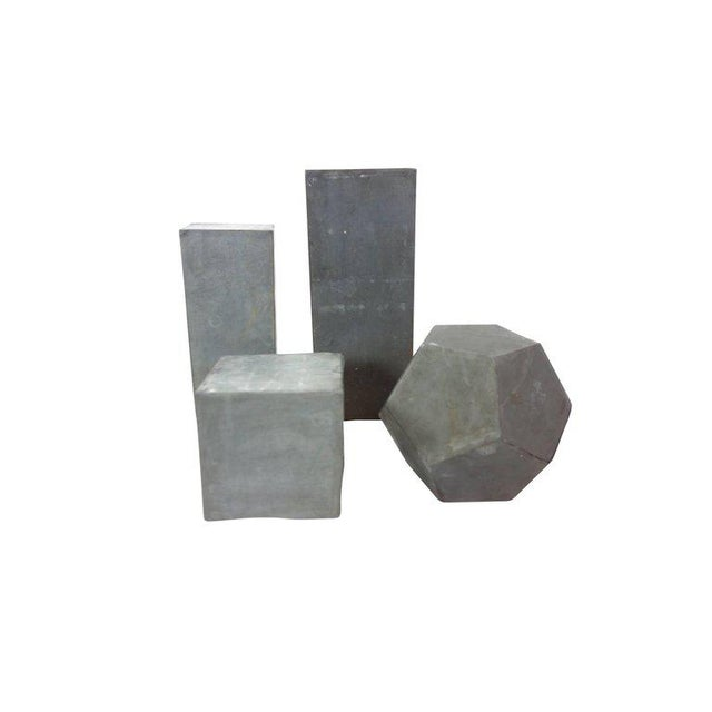 """This is a set of four zinc geometric forms from England used as an educational study, circa 1920. Tall rectangle: 4"""" D x..."""
