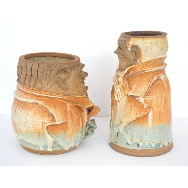 This set of artisan created earthen ware pottery vases are in the stylized forms of the American film actors Laurel and...