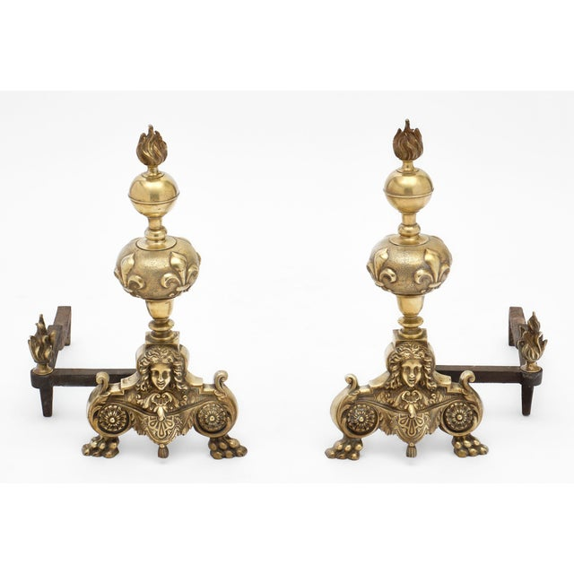 French bronze antique andirons from the 19th century. This set of solid bronze andirons have the strong House of Bourbons...