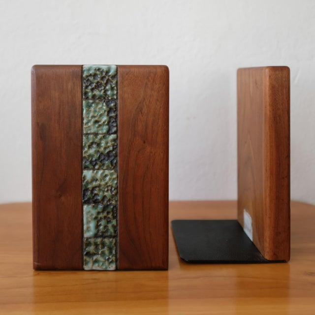 Bookends with ceramic tile by Jane and Gordon Martz for their company, Marshall Studios. Includes a Marshall Studios tag.