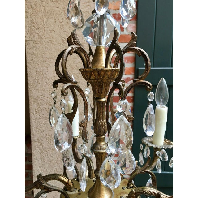 Vintage French Brass Chandelier Light Fixture 6 lamp Candelabra glass directly from France. It has gorgeous serpentine...