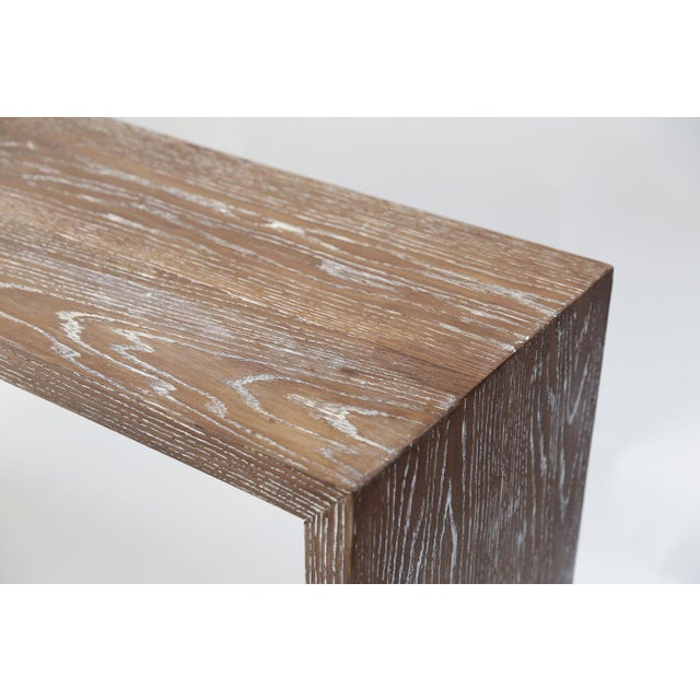 Mid-century cerused oak console, circa 1950-1979. Sold oak console designed in a style reminiscent of the work of Jean-...