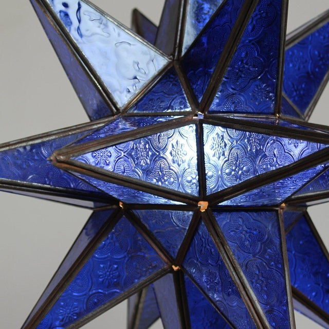 Moroccan blue star shaped lantern with beautifully textured glass and hinged opining for bulb. This lantern creates a...