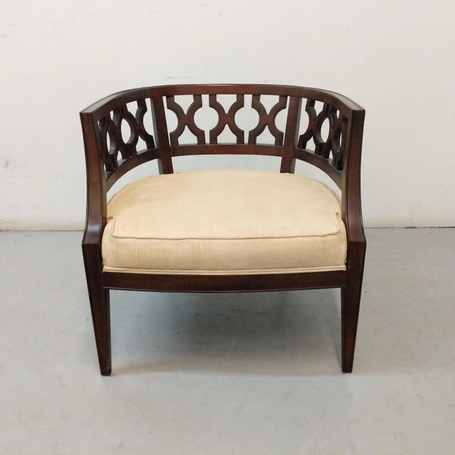 Available for purchase, a fabulous Hollywood Regency lounge chair, in the style of Dorothy Draper. This chair has sits low...