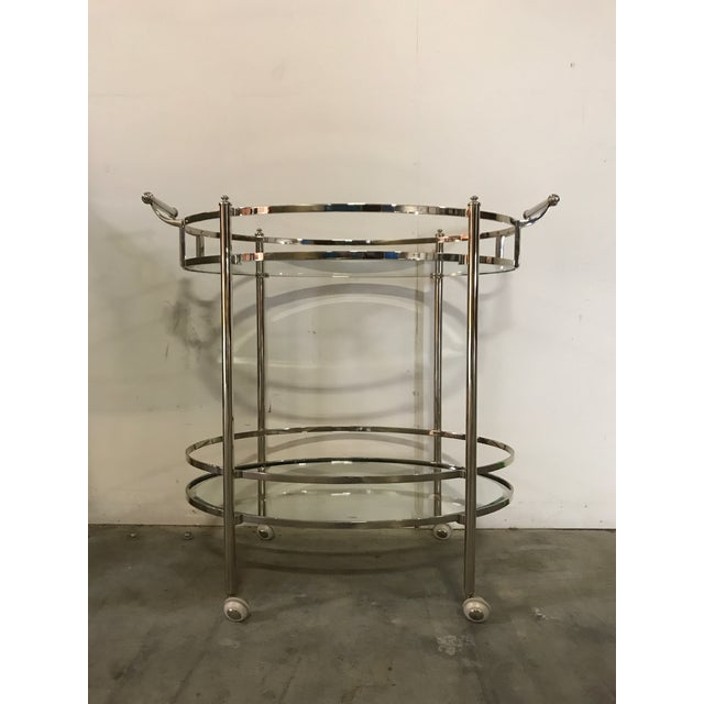 """Polished Nickel Two Tier Bar Cart on wheels with beveled glass shelves. 36"""" w x 24"""" d x 32"""" h. In excellent condition...."""