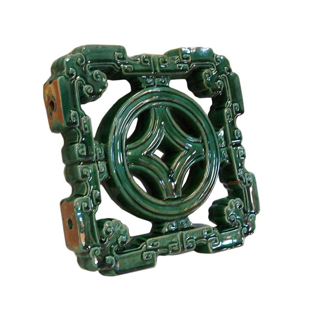 The clay tile is made into elegant Ru-yi Coin pattern and glazed with green color. There is a variation of green, from...