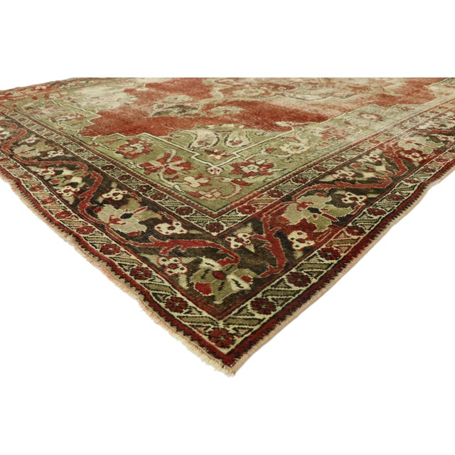 52768 Distressed Vintage Turkish Oushak Rug with Rustic English Manor Style 07'02 x 11'05. With warm spice-tones and...