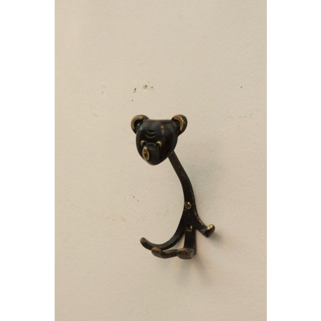 This brass 'Bear' hook was designed by Walter Bosse for Hertha Baller, and produced in Vienna in 1955. The piece is in a...