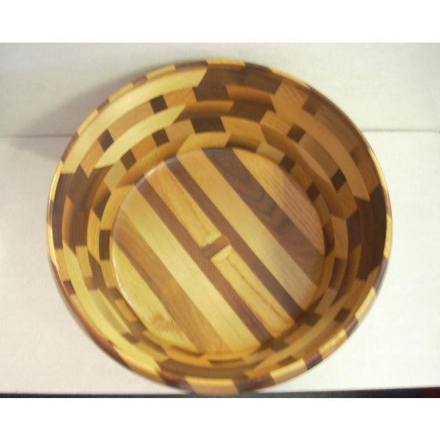 made and signed by Tom Sullivan in 2001; generous size with mix wood geometric segments; casual elegance.