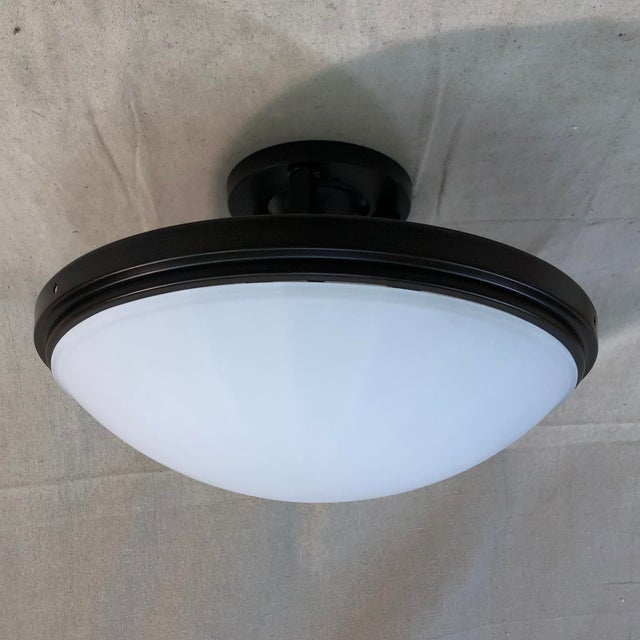 Feiss 2-Light Perry Semi-Flush Mount - Showroom Sample This classy light fixture is constructed of steel with a heritage...
