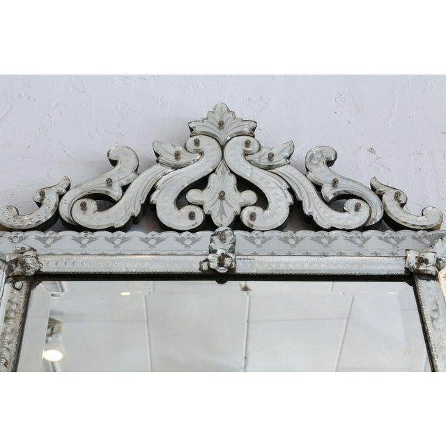 Large rectangular Venetian mirror (circa 1870-1880). Topped by elaborate openwork pediment. Exceptional condition with...
