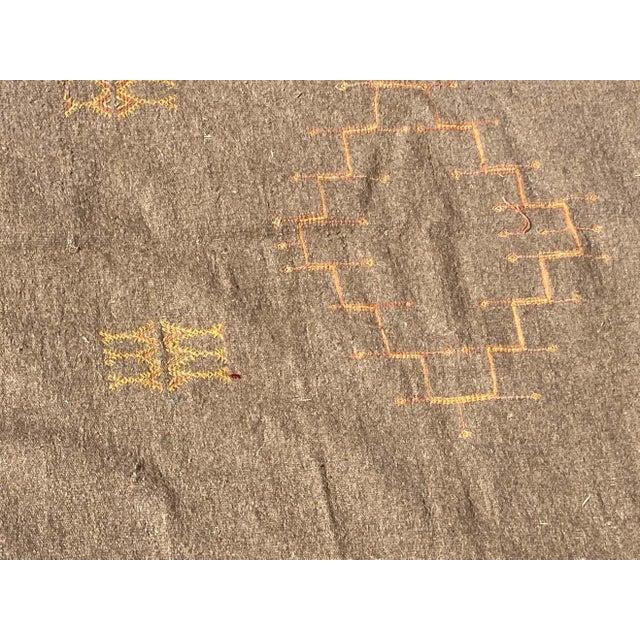Vintage Moroccan flat-weave Kilim rug. Minimalist Berber pattern on a sand color flat weave field. Vintage light brown...