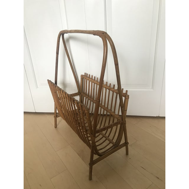 Listed is a rattan magazine rack styled after Franco Albini. A chic way to store magazines, records or books!