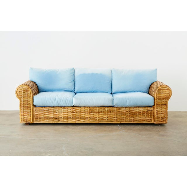 Grand sofa by Ralph Lauren Polo collection constructed from woven bamboo rattan reeds. Features a blue ombre faded soft...
