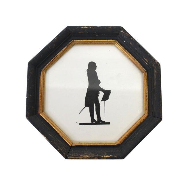 Both in solid wood frames painted gold and black, glazed under glass. The bust version in square frame appears to be a...
