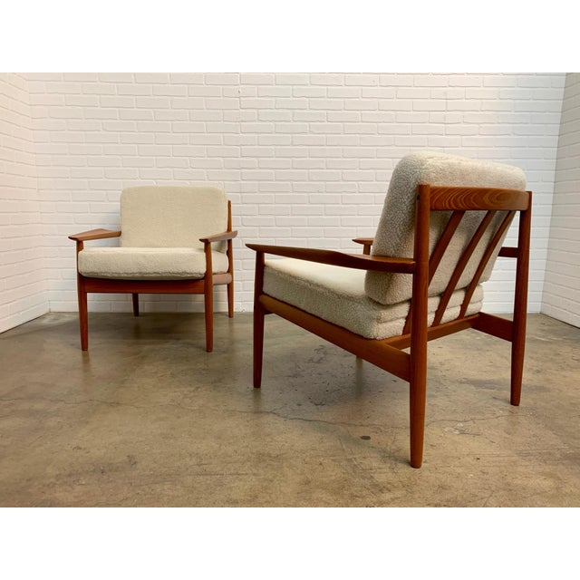 Solid teak armchairs with new Sherpa faux fur designed by Arne Vodder.