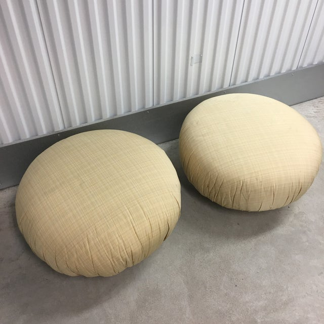 A pair of Steve Chase swivel poufs/ottomans in plaid tan fabric. Perfectly comfortable and ready for some new fabric. Both...