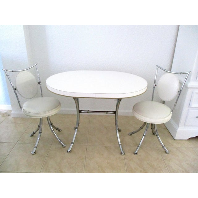 Glamorous mid-century white and bamboo design chrome Hollywood Regency design dinette set consisting of two chairs and one...