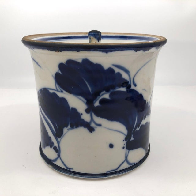 This stunning--positively luminous!--hand thrown porcelain lidded vessel, with lush cobalt blue hand-painted ginkgo leaf...