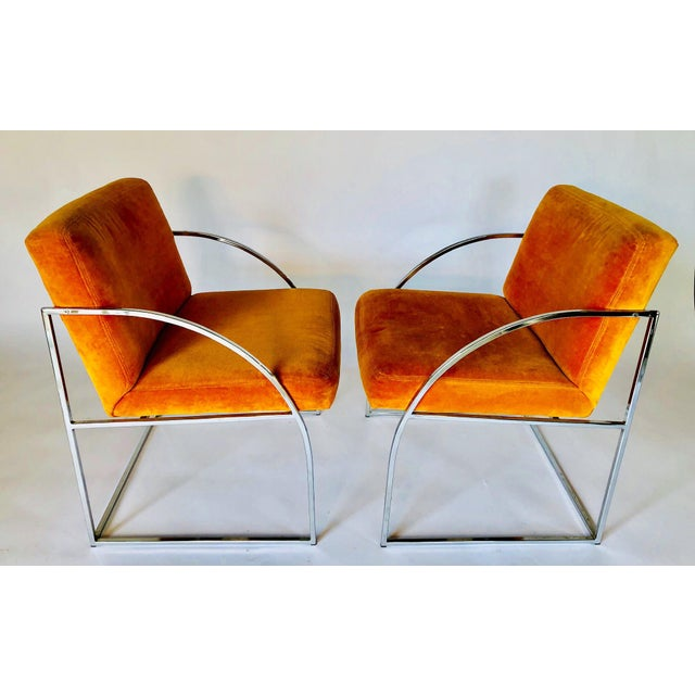 This is a gorgeous pair of Mid-Century Modern chrome frame arm chairs by Milo Baughman for Thayer Coggin. The frame is a...