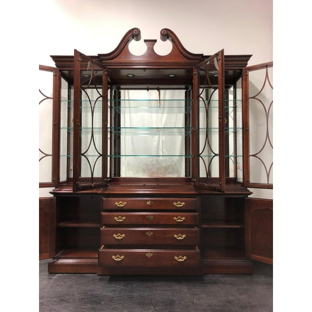 A monumentally sized breakfront by Thomasville from their Collector's Cherry line. Made in North Carolina, USA circa...