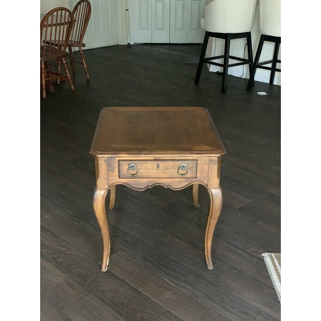 A mid-century maple end table by Hekman Furniture with four cabriole legs, a 2/3-width drawer with uniform dovetailing and...