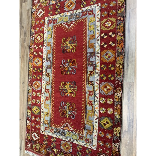 Brilliant and bold Turkish oushack that will make a statement in any space. The eye-catching colors have all of the pop...