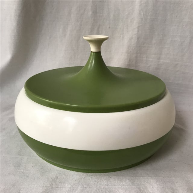 Fantastic and funky vintage canister with olive and white stripes. In good condition with some plastic surface scuffs.
