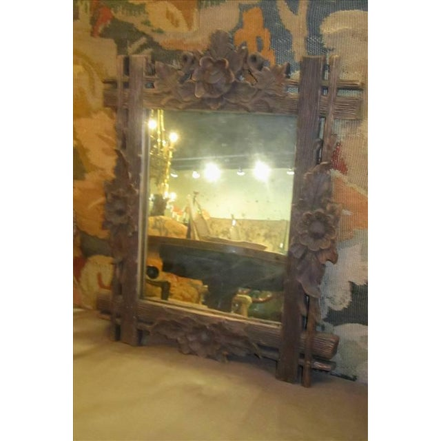 Black Forest carved frame of floral motif surrounding a conforming mirror. AX8-409 Origin: Circa: Width: 13 1/2 Depth:...