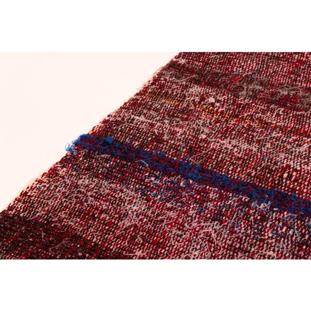 This kilim is delightful in a vibrant palette and easy stripe pattern. A wonderful mix of purple, red, Pink, blue, brown...