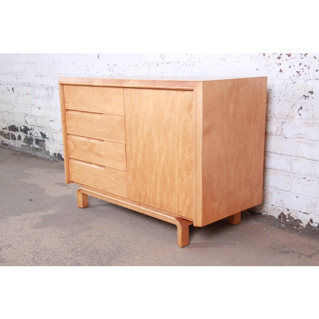 An exceptional mid-century modern maple sideboard or credenza designed by Edmond Spence. The credenza features gorgeous...