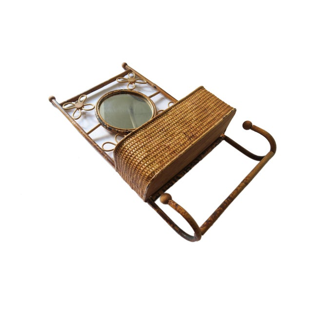 Vintage boho rattan wall hanging caddy and hook storage with round mirror. Perfect for use in a small entryway or powder...