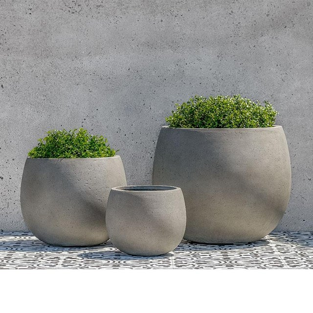 This set of three fiberglass composite planters offers a timeless, elegant feel with a durable, lightweight sensibility....
