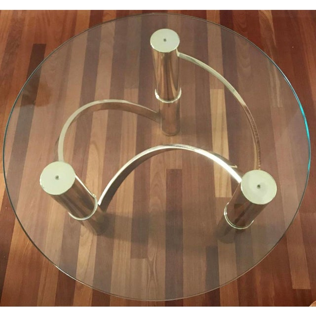 """1980's brass and glass curvy & chic side/end table. Brass and glass in pristine condition. 27"""" round thick glass top. 22""""..."""