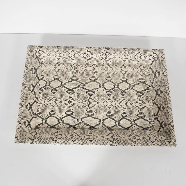 This tray features a shadow box design in faux photon in hues of black and off-white. Would be great on a cocktail table...