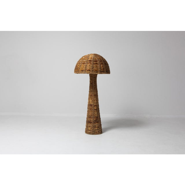 Hollywood Regency floor lamp from the 1960s made from weaved banana leaves around a black metal frame. Fits as well in an...
