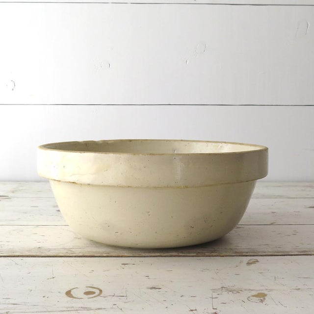 Antique stoneware mixing bowl would be perfect in a modern farmhouse! Heavy stoneware at 4 1/2 lbs, it has a pretty cream...