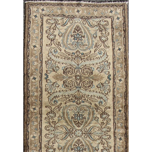 This semi antique lilihan runner features a large-scale vining floral design, which is enhanced by the surrounding all-...