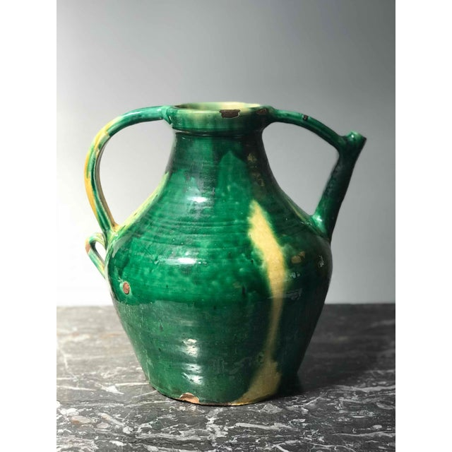 Late 19th century green glazed pot with yellow accents from England.