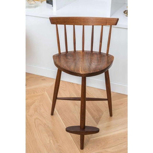 "George Nakashima American walnut ""Mira"" stool."
